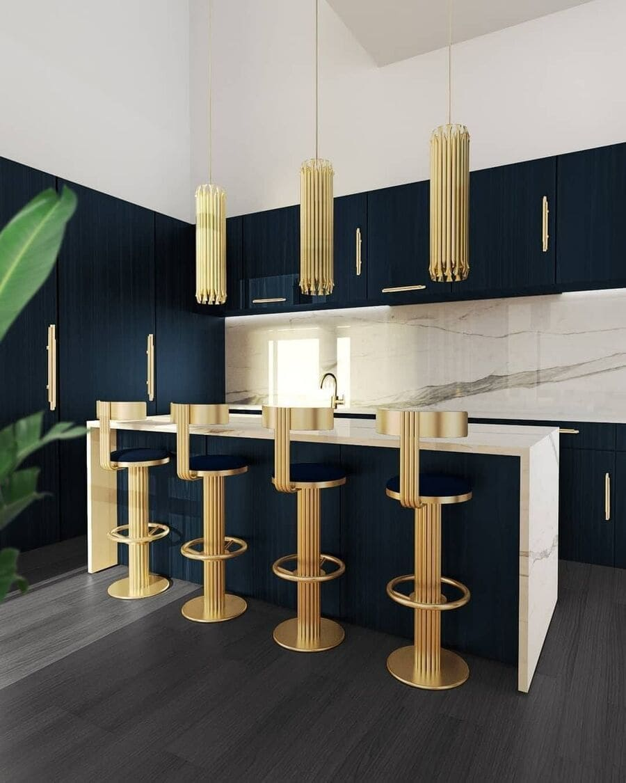 An exquisite kitchen in shades of blue and gold. The gold pendant lamps look amazing in this interior design inspiration.
