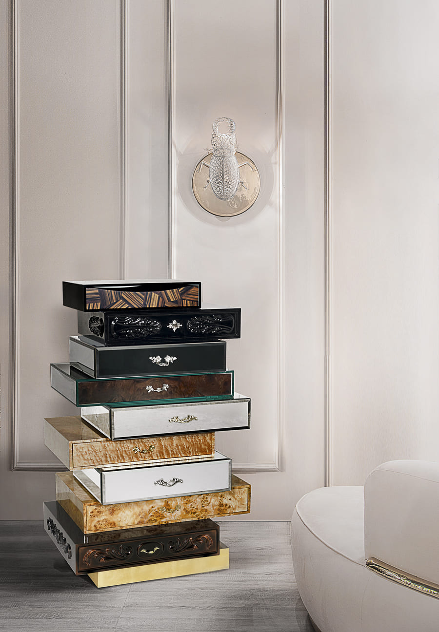 A modern interior design inspiration with a gold and luxurious chest of drawers.