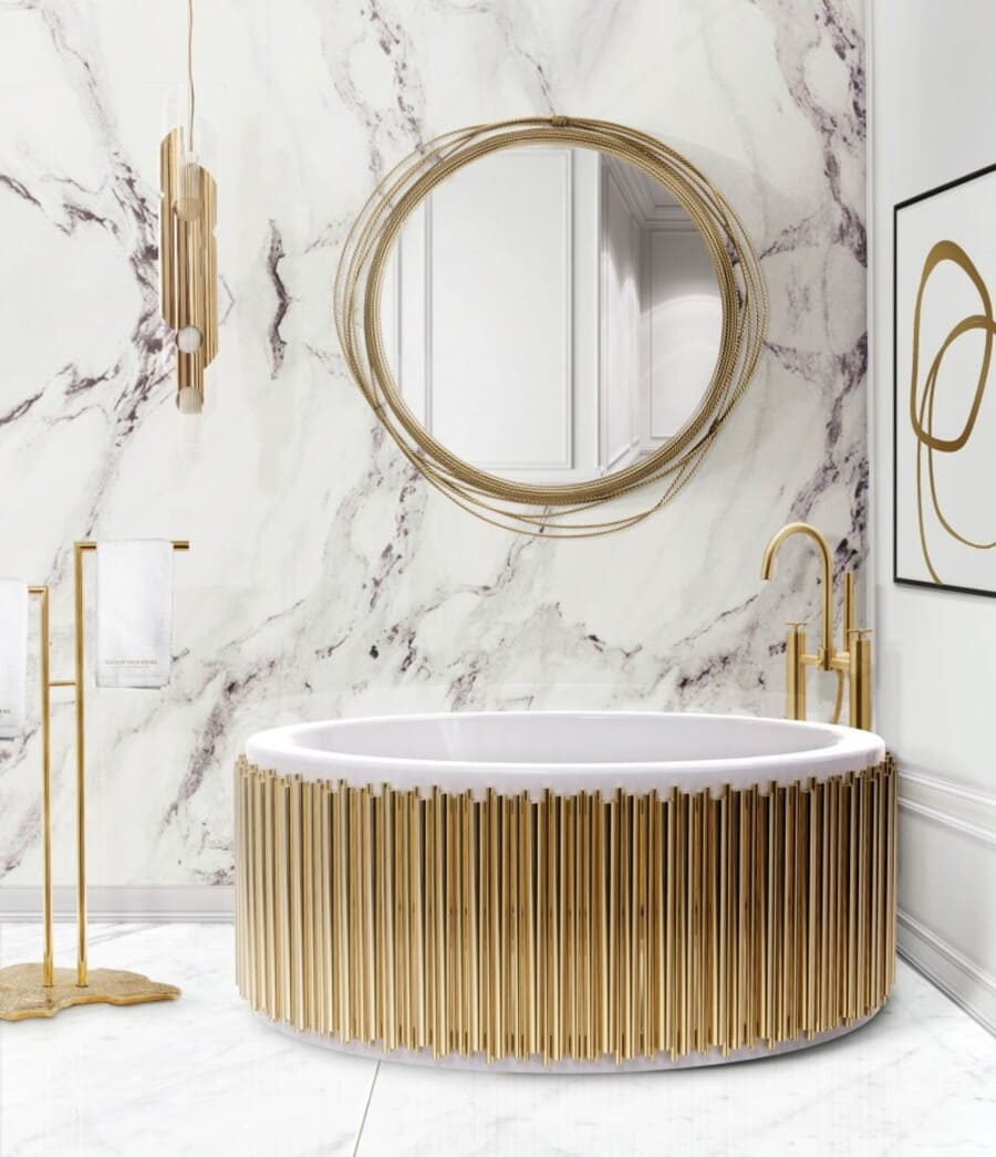 Luxury white marble and gold bathroom with an exquisite bathtub.