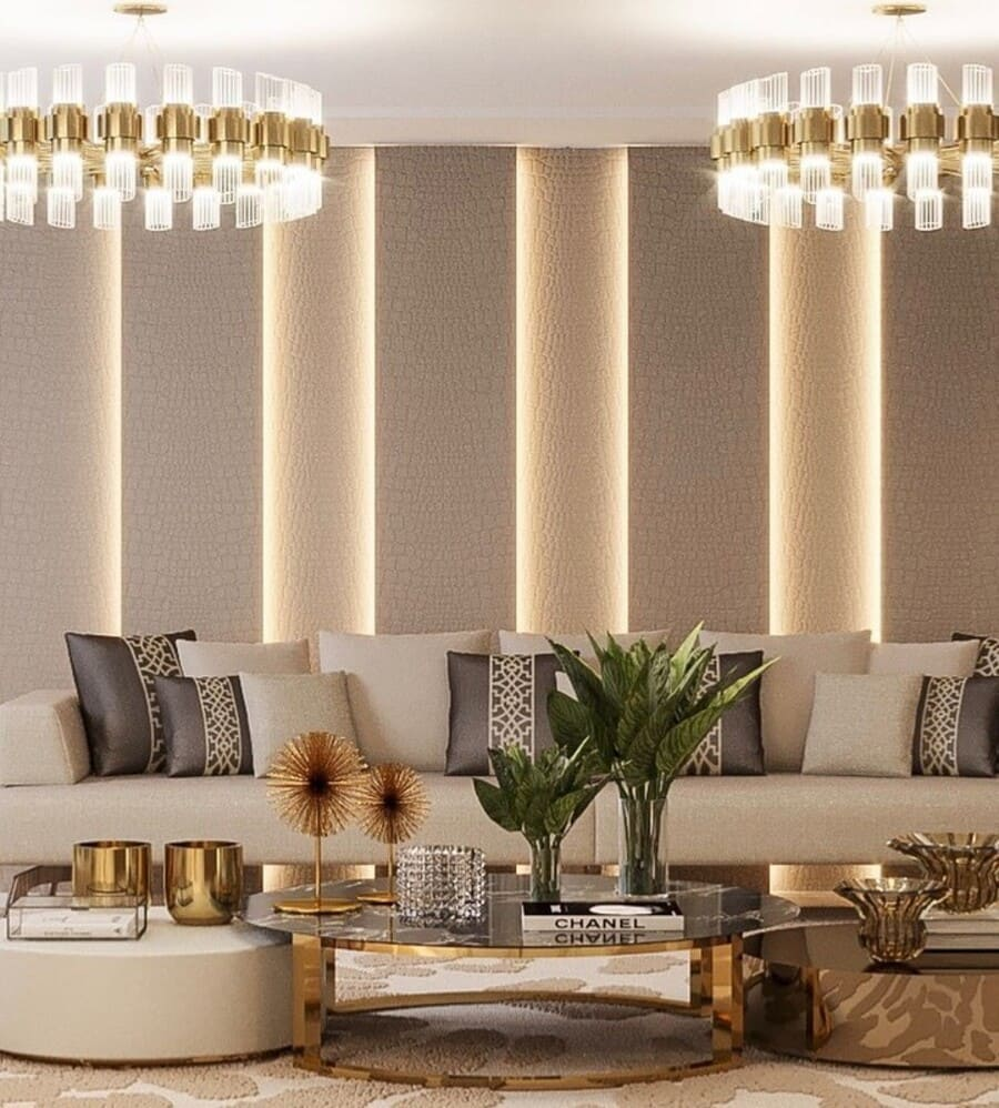 A luxurious interior design inspiration for a living room with a luxury gold chandelier.