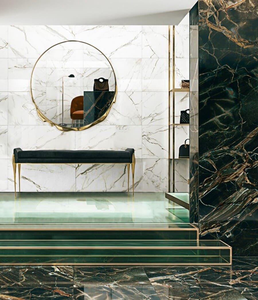 Contemporary bathroom design with green marble and gold details.